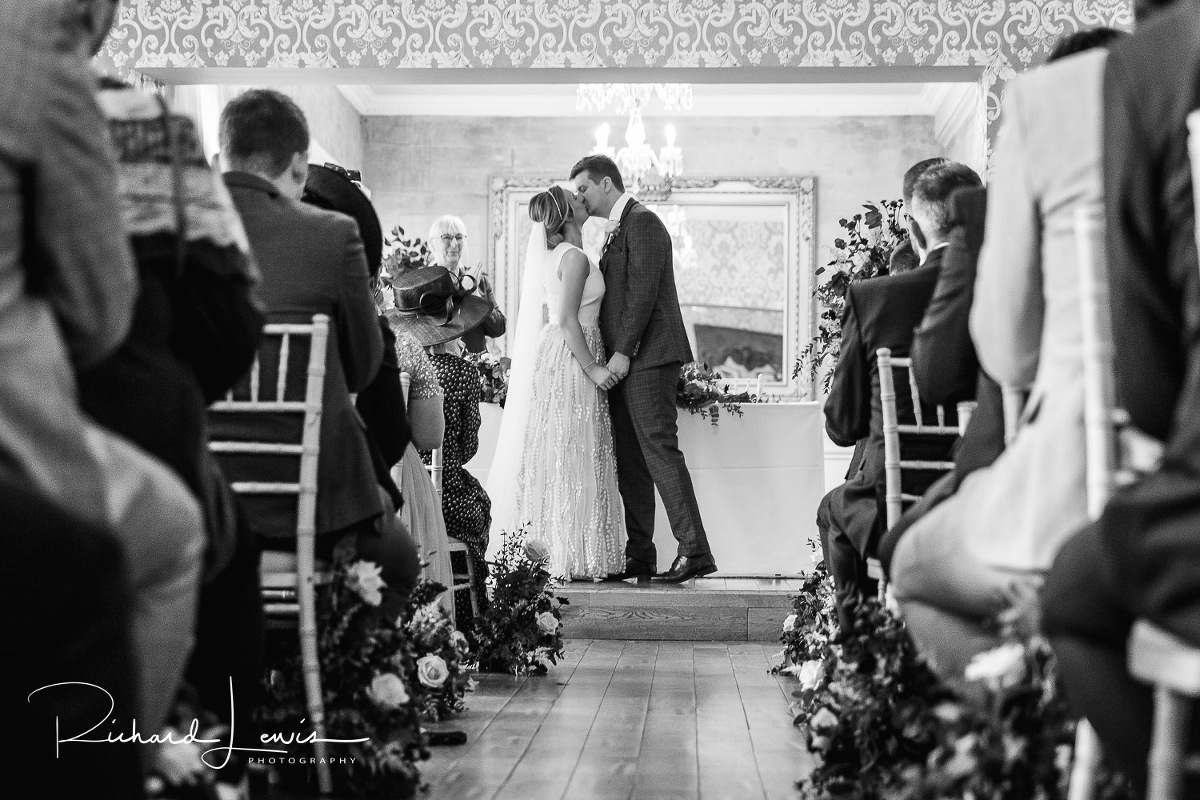 couple kissing after wedding ceremony